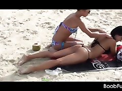 lesbian amateur gets a hot body massage at the beach
