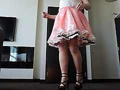 sissy ray in pink sissy dress swirling in hotel room