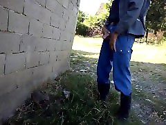 farmer in rubber boots pissing