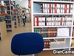 blonde teen girl flashing at the public library