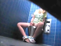blonde masturbating on public bathroom caught under the
