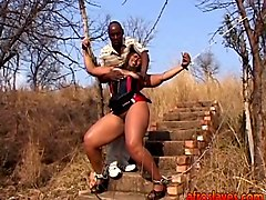 chubby african slave gets tortured outdoors