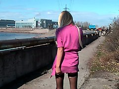 fine blonde russian girl demonstrates her small breasts by the river