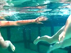 retro footage of two underwater lesbians